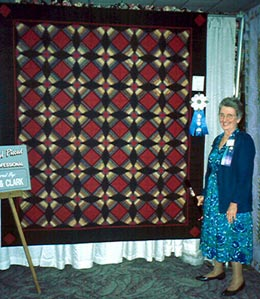 Jane Hall with one of her quilts.